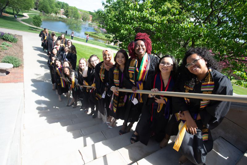 College for Women graduates line up before Commencement