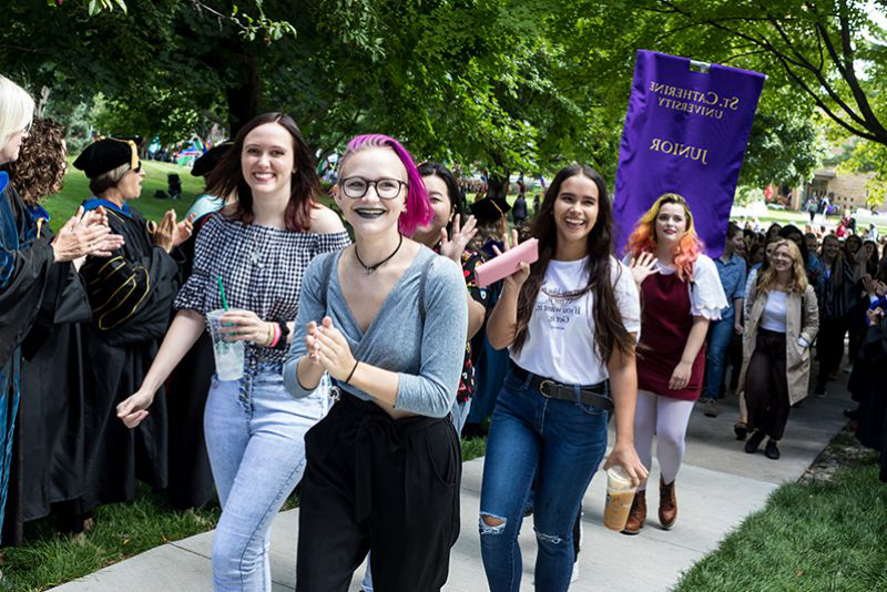 At the University's Opening Celebration, students process to the O'Shaughnessy on our St. Paul campus